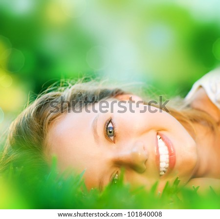Spring Girl in Green Grass - stock photo