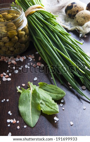 Spring greenness for salad: Welsh onion, sorrel, capers and quail eggs