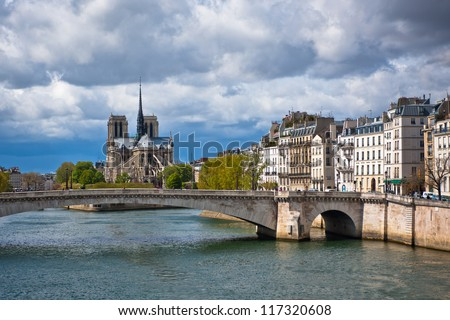 "Spring in Paris. Street with a view to cathedral ""Notre Dame de Paris"" on island Cite in Paris, France. - stock photo"