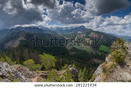 Spring in the high mountains panorama. Rocky summits and slopes covered with forest. Tatra Mountains National Park, Poland - stock photo