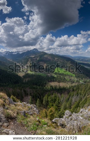 Spring in the high mountains. Rocky summits and slopes covered with forest. Tatra Mountains National Park, Poland - stock photo