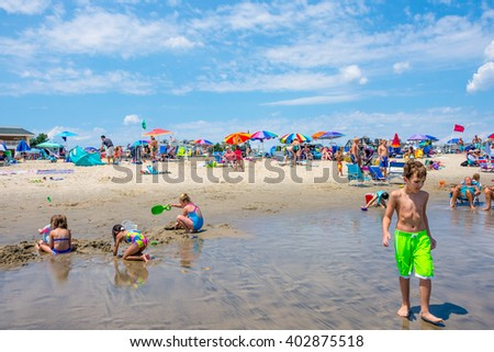 SPRING LAKE, NEW JERSEY-AUGUST 1 - Children playing on the beach on a beautiful day, August 1 2015 in Spring Lake New Jersey. - stock photo