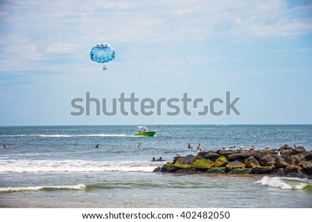 SPRING LAKE, NEW JERSEY-AUGUST 1 - Parasailing along the coast on August 1 2015 in Spring Lake New Jersey. - stock photo