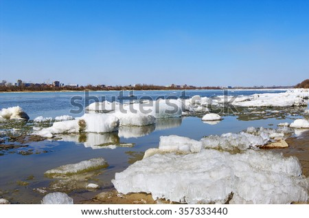 spring landscape, drifting ice-floe on Irtysh river, Omsk, Russia