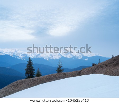 Spring landscape in the mountains. Cloudy day. View of the snowy mountain range. Mount Goverla, Carpathians, Ukraine, Europe. View from the Kostrych Ridge