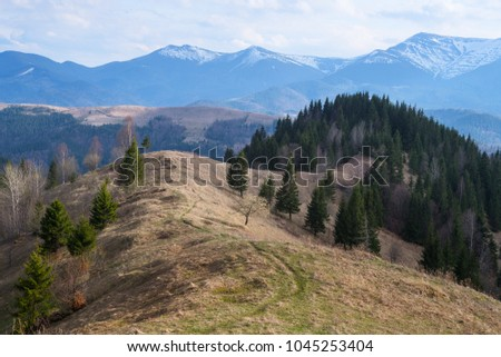 Spring landscape in the mountains. Cloudy sky