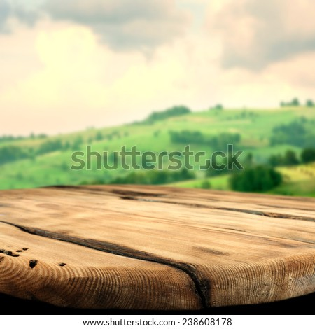 spring landscape of green tuscany and worn old texture table space  - stock photo