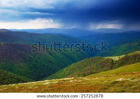 Spring landscape. Rainy day. Stormy sky in the mountains - stock photo