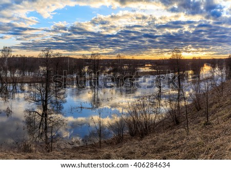 Spring landscape, sunset over the swollen river