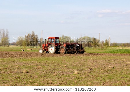Spring landscape.Tractor sowing seeds in the field