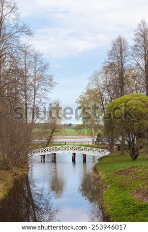 Spring landscape with a bridge over a stream