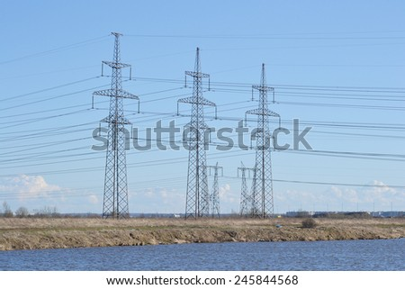 Spring landscape with electricity pylons, outskirts of St. Petersburg, Russia. - stock photo