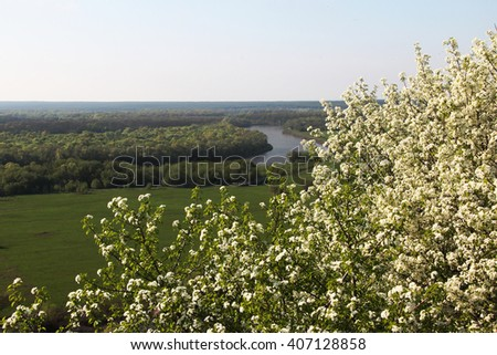 Spring landscape with rivers and hills - stock photo
