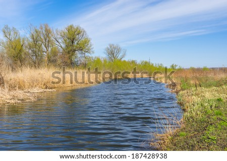 Spring landscape with small Ukrainian river Sura - stock photo