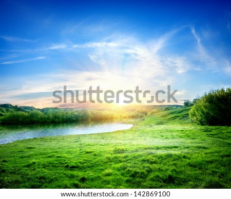 Spring landscape with the river and the sun