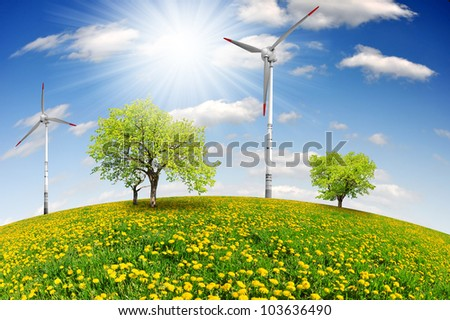 spring landscape with wind turbine - stock photo