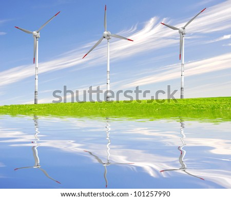 spring landscape with wind turbines - stock photo
