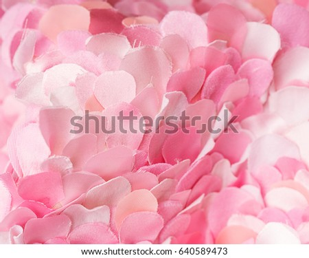 Spring light pink textile petals composition. Flower blossom wallpaper, top view