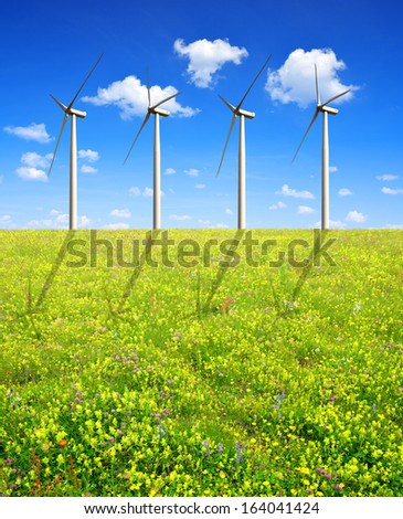 Spring meadow with wind turbines