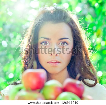 Spring mood and bright fresh red apples in beautiful woman hands - stock photo