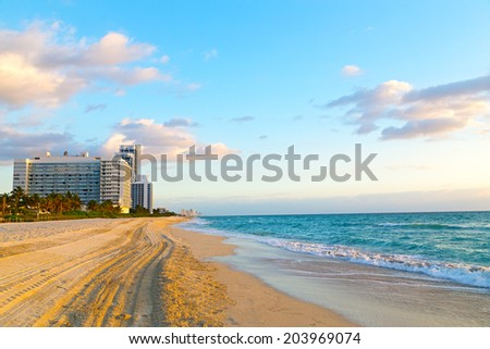 Spring morning at the ocean beach. Miami Beach at sunrise with resorts in a view. - stock photo