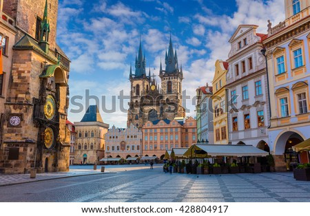 Spring morning on the Old Town square with Tyn Church. Sunny sityscape in capital of Czech Republic - Prague, Europe. Artistic style post processed photo.