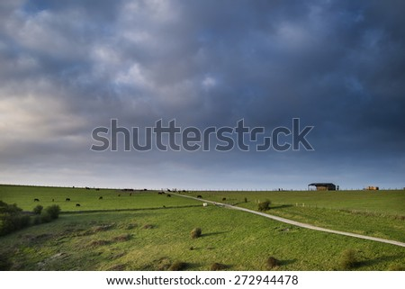 Spring morning over agricultural landscape in English countryside - stock photo