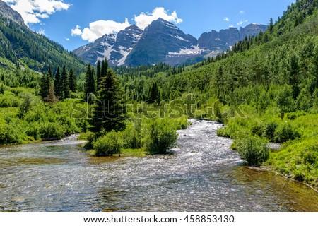 Spring Mountain Creek - Spring snow-melting water running down Maroon Creek at base of Maroon Bells, Aspen, Colorado, USA. - stock photo