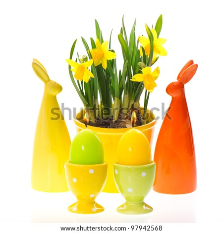 spring narcissus flowers with easter bunny decoration - stock photo