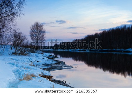Spring nature, sunset scenery.  Season river with ice