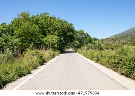 Spring on Crete. It is all green. On the old route to Rethymno. The road connected the south with the north and leads along spectacular landscapes. The terrain is situated in the central of Crete