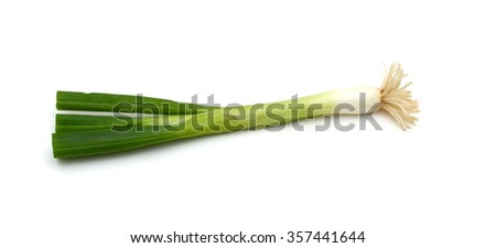 Spring onions also known as salad onions, green onions or scallions on the white background - stock photo