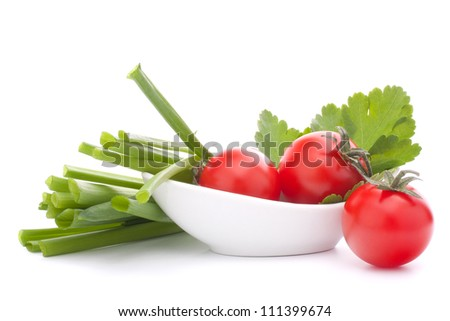 Spring onions and cherry tomato in bowl isolated on white background cutout - stock photo