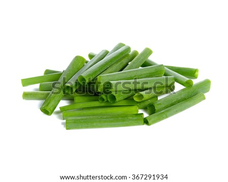 spring onions sliced on a white background - stock photo