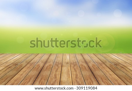 Spring or summer abstract season nature background with bokeh lights and wooden plank - stock photo