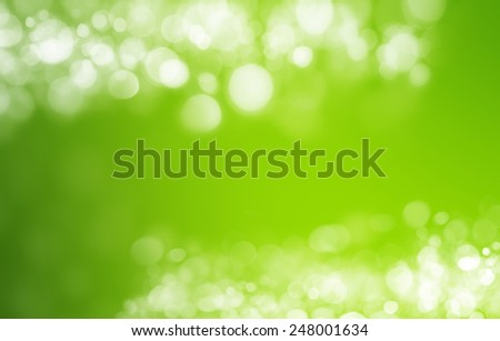 Spring or summer heat abstract nature background with grass in the meadow and sunset with sun beams and bokeh lights in the back - stock photo