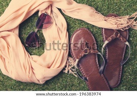 Spring or summer women's fashion accessories lying on grass - stock photo
