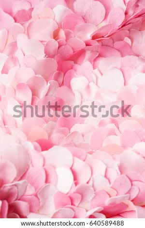 Spring pink textile petals background. Flower blossom wallpaper, top view