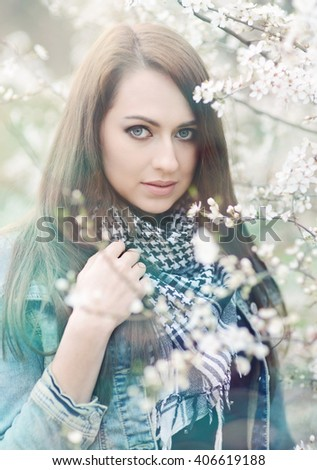 Spring portrait of beautiful young brunette