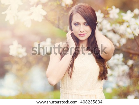 Spring portrait of beautiful young brunette - stock photo