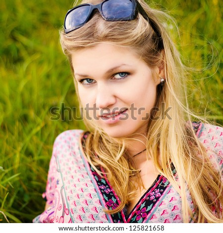 Spring portrait of young smiling woman - stock photo