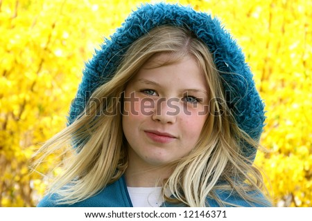 Spring portrait of young teen with yellow flowers in the background - stock photo