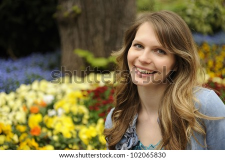 spring: portrait of young woman with flowers - stock photo