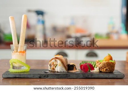 Spring roll with mango wasabi mayo, Grilled eggplant with Scallop spicy cheese, Tako tempura roll and Namasu Kabayaki, Kumquat stuffed with smoked duck and mash potato in noodle nest - stock photo