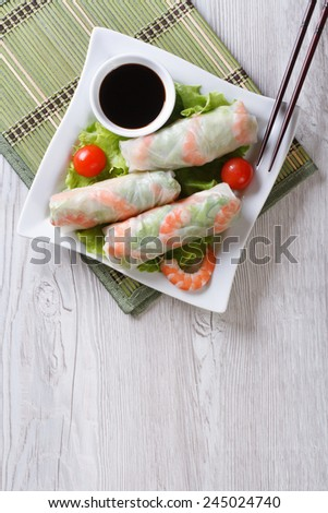 spring roll with shrimp and sauce on a plate. vertical view from above  - stock photo