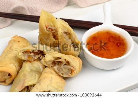 Spring Rolls - Fried vegetable spring rolls served with sweet chili sauce. Close up. - stock photo