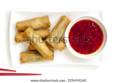 Spring rolls with chili sauce and chopsticks.  Overhead view. - stock photo
