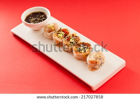 spring rolls with soy sauce - stock photo