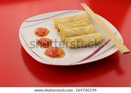 Spring rolls with sweet and sour dipping sauce on a plate