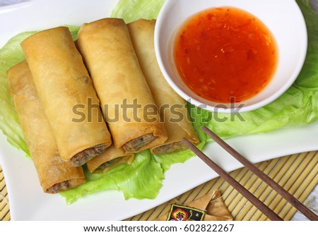 Spring rolls with sweet chili sauce.